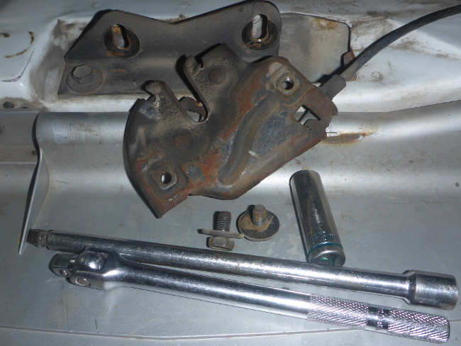 Front hood latch stuck , how to ...
